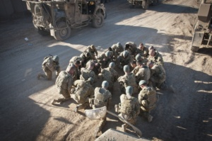 U.S. Army Soldiers from 2nd Platoon, Company A, 1st Battalion, 2nd Infantry, 172nd Infantry Brigade, Task Force Blackhawk, bow for a moment of silence to honor their fallen comrades before leaving on a mission outside the wire of Combat Outpost Yosef Khel in Afghanistan.
