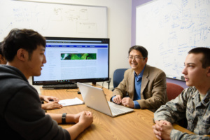 Feng Luo meets with his team in McAdams Hall at Clemson University.