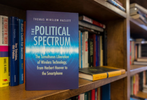 Dr. Thomas Hazlett's book, The Political Spectrum, sits on a shelf in his office