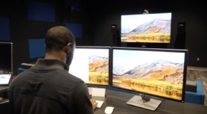 A student works in the video production room of the Zucker Family Graduate Education Center.