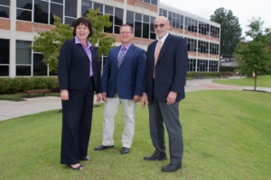 From left, College of Science Dean Cynthia Young stands outside Martin Hall alongside professor Kevin James and Christoph Cox, the newly named acting director of the School of Mathematical and Statistical Sciences.
