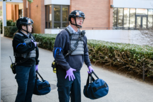 Kim Shivar and Matt Wall prepare to enter the premises of Daniel Hall during the university's active shooter exercise.