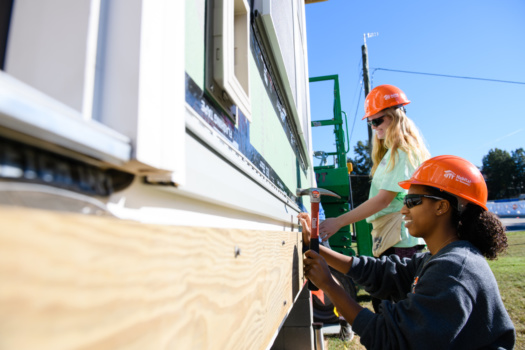 Photo of student volunteers working on last year's Habitat for Humanity Homecoming house.