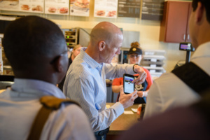 Steve Robbins of TigerOne Card Services demonstrates a transaction using mobile ID at a retail dining location in Hendrix Student Center.