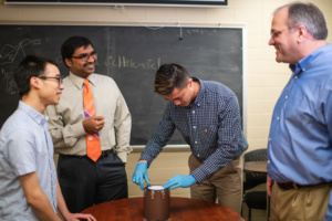 Joseph Singapogu (second from left) is leading the development of a simulator aimed at teaching future vascular surgeons how to suture blood vessels.