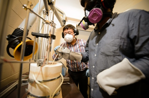 Hongseok Choi, left, works in his lab in the Fluor Daniel Engineering Innovation Building at Clemson University.