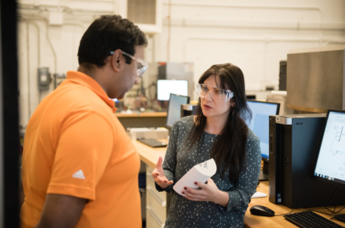 Simona Onori, right, talks with Harikesh Arunachalam, a Ph.D. candidate who works in her lab at the Clemson University International Center for Automotive Research.