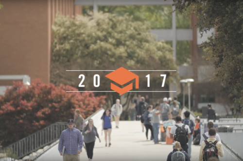 Image of Clemson students walking across the bridge. Overlaid on top of it is a graduation cap and 2017.
