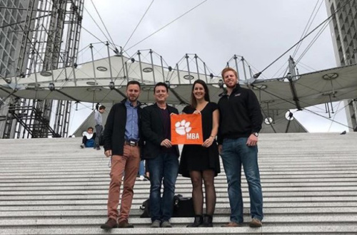 Students stand in Paris holding a Clemson Tiger Rag.