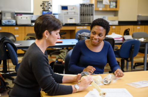 Julia Brisbane, right, works with Melinda Harman in the Rhodes Engineering Research Center at Clemson University.