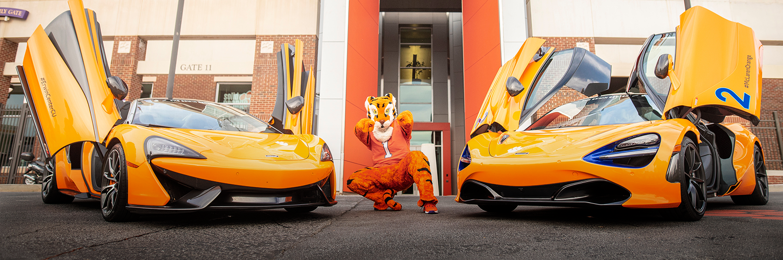 The Clemson Tiger poses with a McLaren 570 and a McLaren 720 in front of Memorial Stadium.
