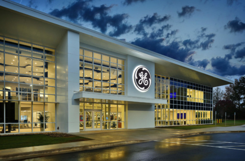 Outside view at night of GE Power's Advanced Manufacturing Works facility in Greenville.
