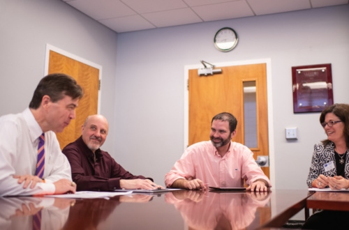 From left: Timothy Fulford of Trident Technical College, Joe Santaniello of Spartanburg Community College, Christopher Kitchens of Clemson University and Shawn Masto of Spartanburg Community College meet in Clemson University's Earle Hall to plan SPECTRA, a program that makes $3 million in new scholarships available to students who transfer from technical colleges to Clemson to study engineering or computing.