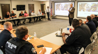 Jonathan Aronie (speaking) and Otha Sandifer presented recently to Clemson University Police Department and other partners on the integration of skills and practices that make up ethical policing.